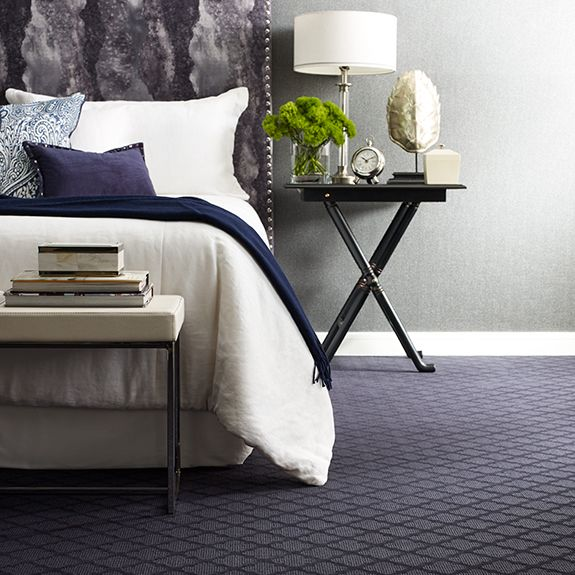 Beautiful carpeted bedroom with furniture accents